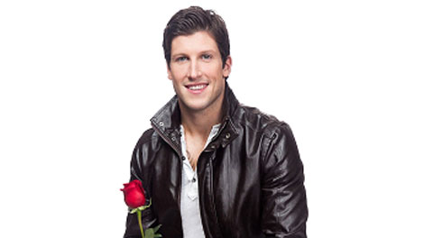 Bachelor Canada Brad Smith with a rose