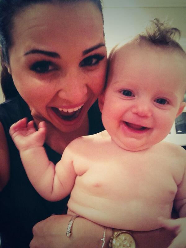 Andi Dorfman poses with Cassie Lambert's baby